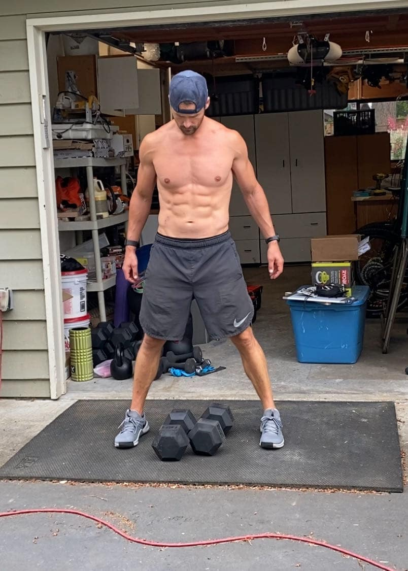 Joe Bauer standing in driveway with dumbbells